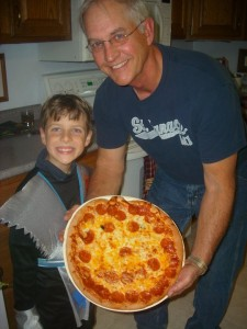 Sam and Papa with the pumpkin pizza in 2009.