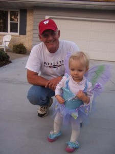 Papa and a tiny little Claire dressed like a fairy.