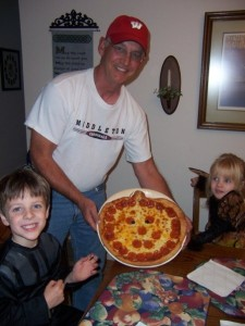 Sam and Anna with Papa and the pumpkin pizza in 2008.